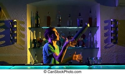 Professional barman making cool, amazing tricks using three...