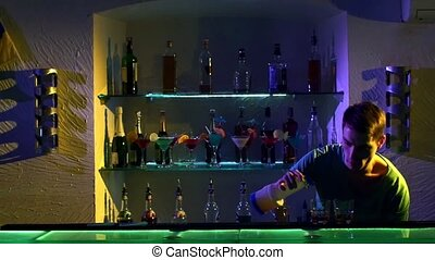 Professional barman making cool, amazing tricks using...