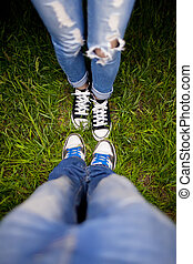 Two pairs of shoes on a green meadow