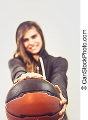 Girl with a basketball - Girl is holding a basketball and...