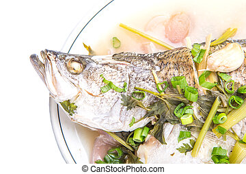 Steamed Asian Bass Fish - Malaysian dish of sweet and sour...