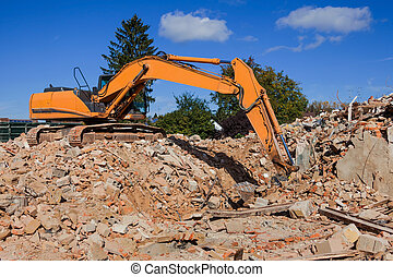 abbruchhaus - a house is demolished. excavator on the...