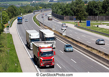 truck on highway - trucks on a three-lane highway symbolic...