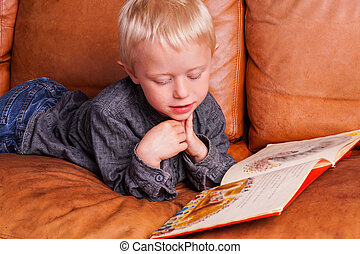 Child reads in one Book - Child with Book The Boy are lying...