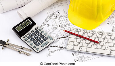 house plan with a construction worker's helmet - a blueprint...
