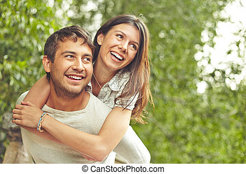 Couple in park - Cheerful couple spending time outdoors