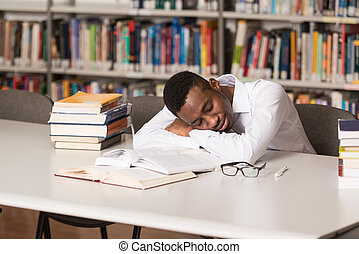 Male Student Sleeping In Library - Sleeping African Student...