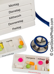 tablet dispenser and stethoscope, symbol photo for therapy,...