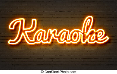 Karaoke neon sign on brick wall background