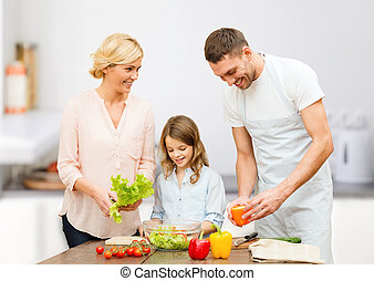 happy family cooking vegetable salad for dinner - vegetarian...