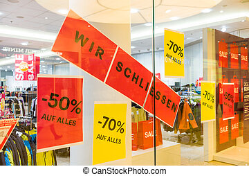"sign: ""we conclude"" - a business in a shopping center is..."