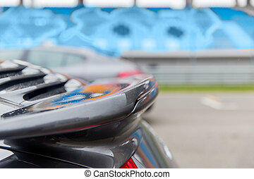 close up of car spoiler on speedway at stadium - racing,...