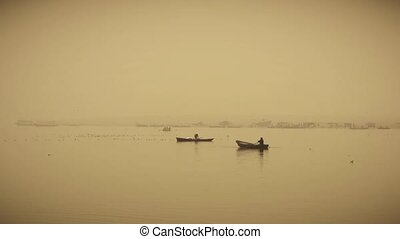 India, small boats on ganges river - Varanasi, India, boats...