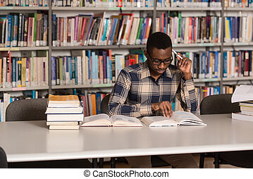 African Man Studying In A Library - Portrait Of African...