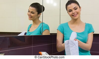 Young woman wiping her hands - Everything is clean Young...