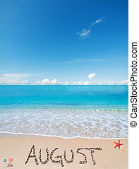 august on a tropical beach under clouds - august written on...