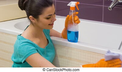 Young woman polishing bath - Diligent polishing. Young...