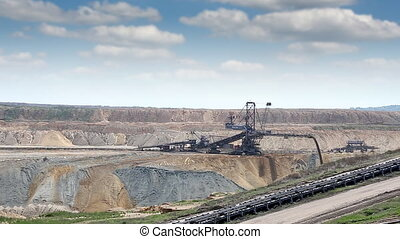 excavator digging on open pit coal mine