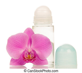 Deodorant and orchid flower - Roll deodorant and pink orchid...