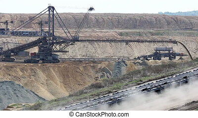 giant excavator digging on open coal mine