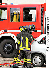 brave firefighters relieve an injured after a road accident...