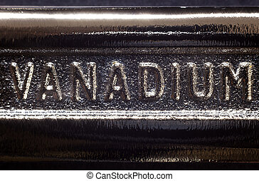 Vanadium - Written word on metal, part of industrial tool.