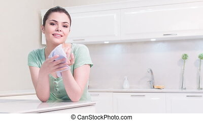 Woman cleaning her hands in kitchen