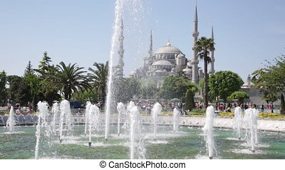 TURKEY, ISTANBUL - MAY 12, 2015: Tourists on Sultanakhmet Square in Istanbul. Sultanakhmeet (Sultanahmet) - the area in old part of Istanbul located in the European part of the city.