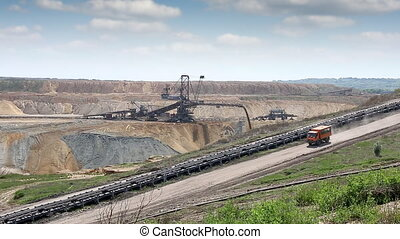 open pit coal mine with excavators and truck