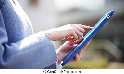 business woman hands with tablet pc in city - business,...