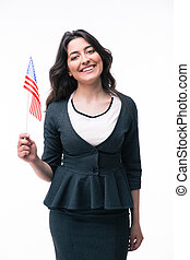 Smiling businesswoman holding US flag isolated on a white...