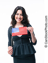 Happy businesswoman holding US flag isolated on a white...