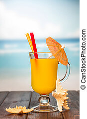 Juice on a wooden table - Juice in a glass decorated with...