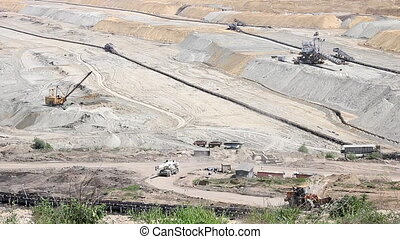 open pit coal mine with machinery