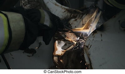 Firefighters working with welding,close up of a welder on...
