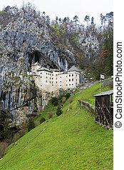 Predjama Castle - The beautiful view of Predjama Castle in...