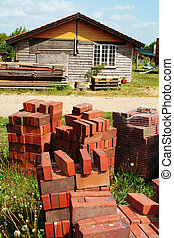 brick pile building materials - building site with pile of...