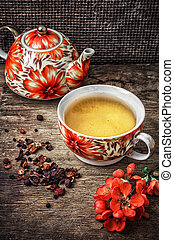 porcelain cup of fragrant tea for medicinal herbs in retro...