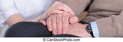 Close-up of hands - Close-up of nurse holding aged mans...