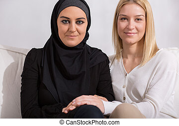 Friends of different religion - Muslim and christian girl -...