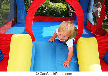 child bouncy castle - child on bouncy castle. inflatable...