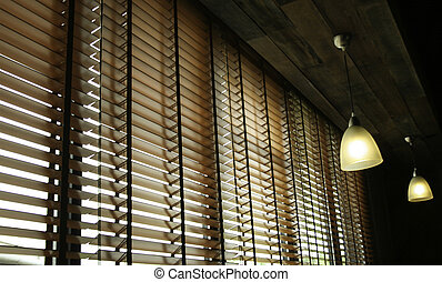 Blinds in a home catching the sunlight