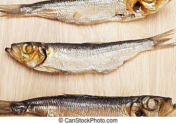Smoked fish above view - Smoked fish on cutting board above...