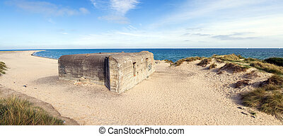 German war bunker on beach by sea - german bunker from...