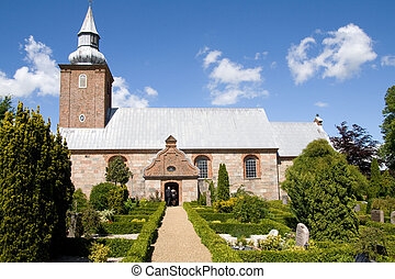 medieval danish church and graveyard. old religious building...