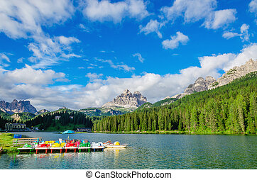 Colored pedalos on Lake Misurina, Dolomites, Italy - Colored...