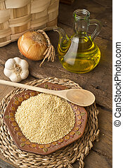 Millet and olive oil rustic background - Millet from organic...