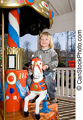 merry-go-round horse carousel - child on merry-go-round...