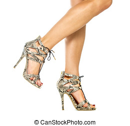 Female legs in High Heels Shoes with animal print design -...