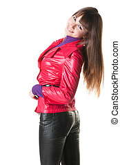 beautiful smiling woman in leather pants. Isolated over...